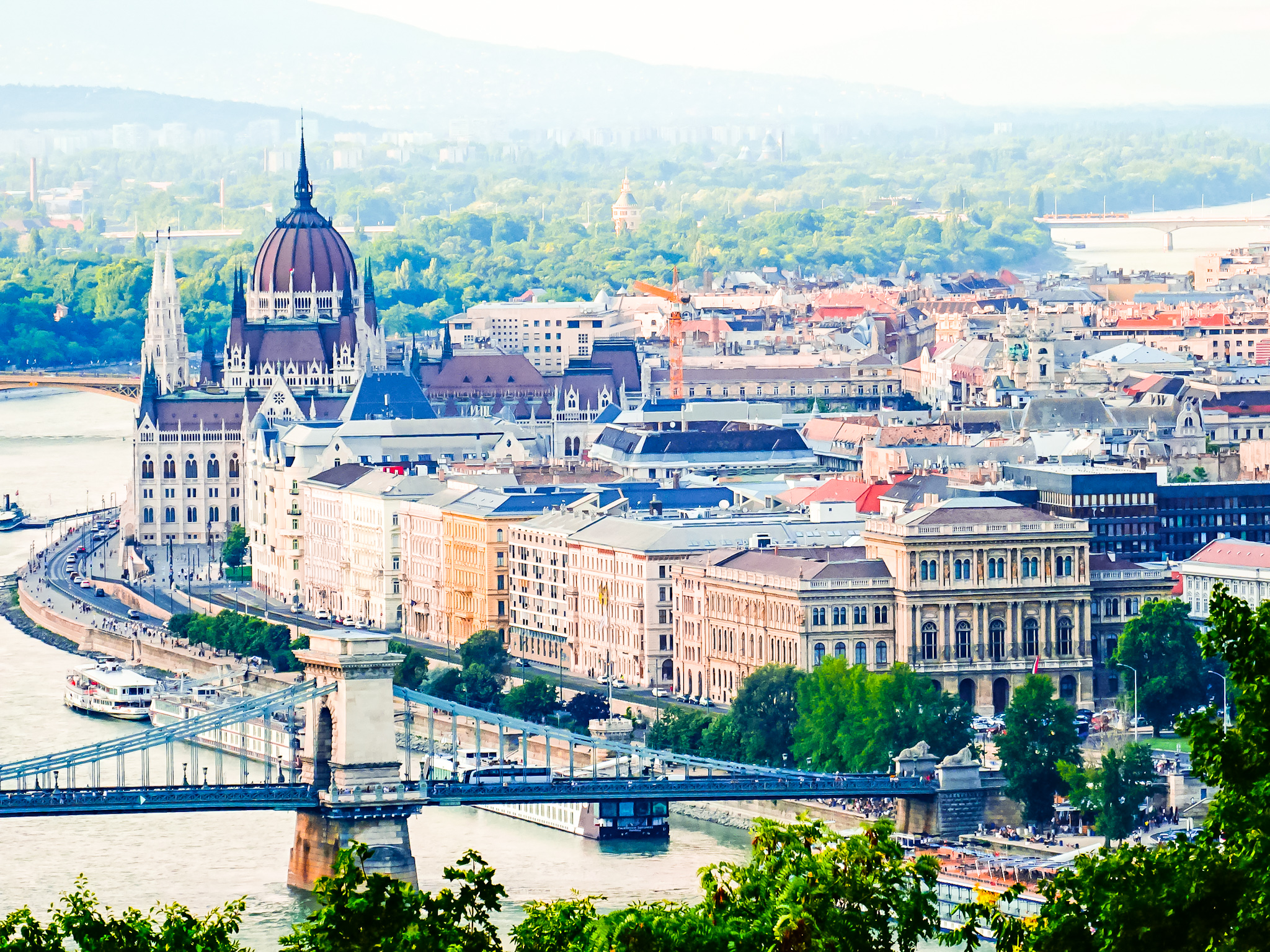 View From Gellért Hill of Budapest, Danube, and the Parliament building. Explore and travel Hungary!