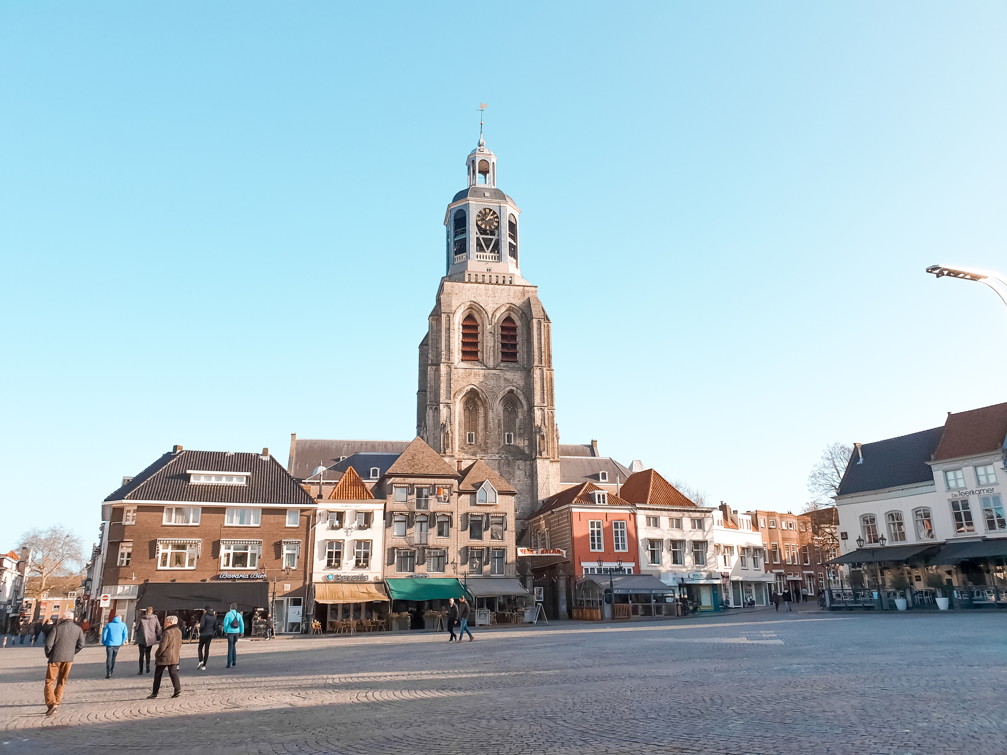 View of Grote Markt, the central square in Bergen op Zoom. Things to do and what to see when traveling to Bergen op Zoom. Perfect for a day trip or staying the entire weekend. Travel the Netherlands and find charming Dutch towns. #discover #europe #vacation