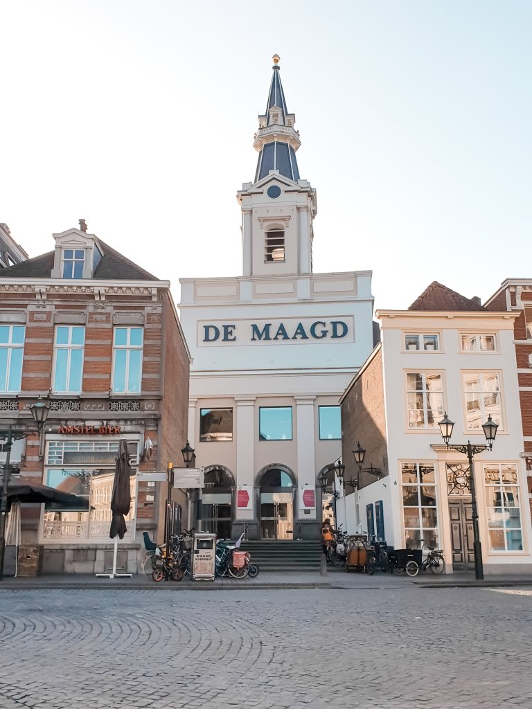 Theater De Maagd at Grote Markt, the central square in Bergen op zoom. Things to do and what to see when traveling to Bergen op Zoom. Perfect for a day trip or staying the entire weekend. Travel the Netherlands and find charming Dutch towns. #discover #europe #vacation