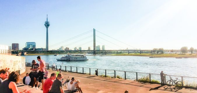 A weekend in Düsseldorf with rhine, tower, and knee bridge at rhine stairs in old town! #thingstodo #germany #europe #travel