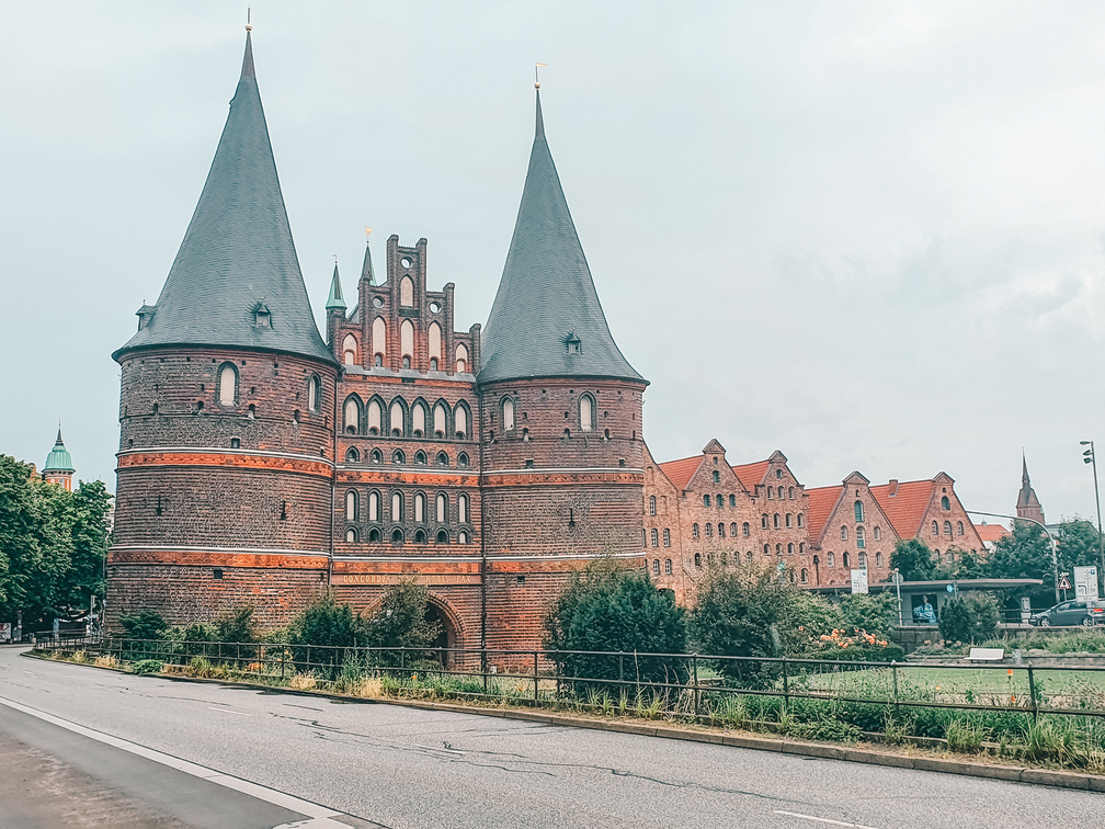 """While traveling Baltic Sea visit Lübeck and """"Holstentor"""" one of the most famous landmarks in Germany while traveling the Baltic Sea in Schleswig-Holstein"""